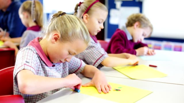 education children doing school work in class - primary school child stock videos & royalty-free footage