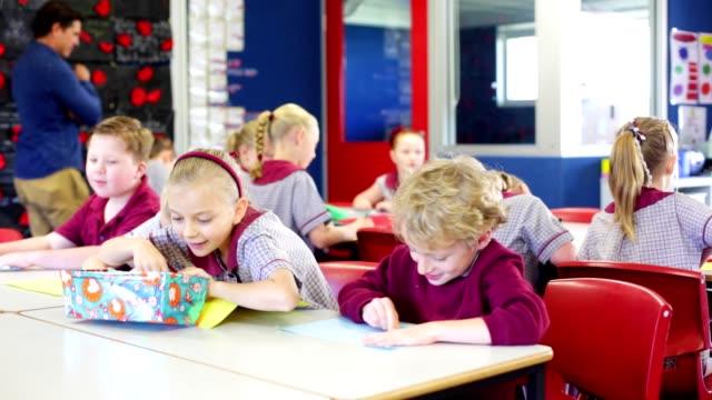 education children doing school work in class - elementary school stock videos & royalty-free footage