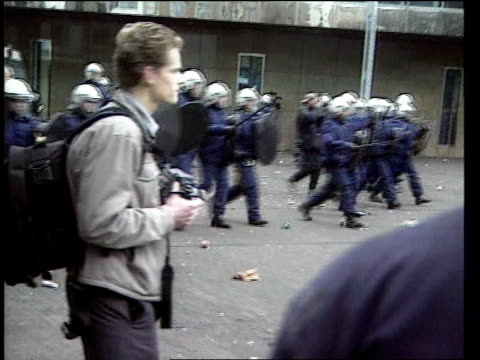 stockvideo's en b-roll-footage met holland students protest against national curriculum itn mass of protesting students pan gv line of riot police along pan gv students charging... - 1999