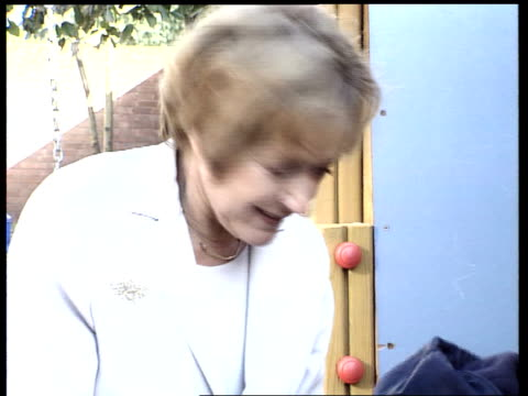 nursery school learning tagets itn england london nursery school children playing in sandpit as education minister margaret hodge mp watching cms... - マーガレット・ホッジ点の映像素材/bロール
