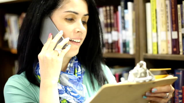 education-librarian placing order for additonal books. - librarian stock videos & royalty-free footage
