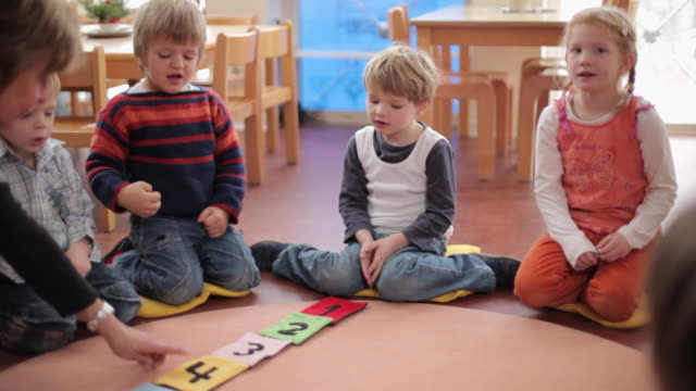 ms pan educator and children counting little bags / potsdam, brandenburg, germany - preschool stock videos & royalty-free footage