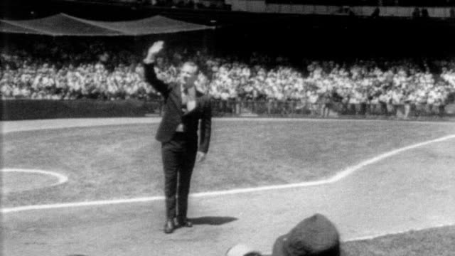 edward charles 'whitey' ford retires from baseball / ford comes onto field at yankee stadium dressed in suit / crowd gives standing ovation as he... - new york yankees stock-videos und b-roll-filmmaterial