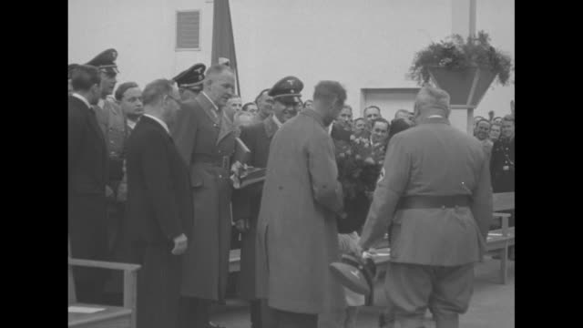 Edward Duke of Windsor exits doorway during visit to Nazi Germany / Wallis Simpson Duchess of Windsor walks with Duke and group / Edward arrives at...