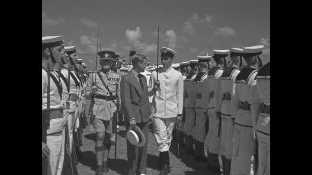 edward duke of windsor reviews troops upon his arrival in bermuda / duke reviews british naval sailors in the bahamas / british flag / duke reviews... - bahamas stock videos & royalty-free footage