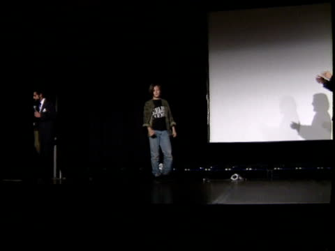Edward Furlong comes out on stage and waves to fans with James Cameron