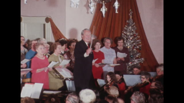Edward Heath conducts a choir and orchestra during a carol concert in Broadstairs Kent