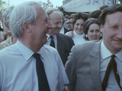 vidéos et rushes de edward heath signs an autograph during election campaigning in croydon - autographe