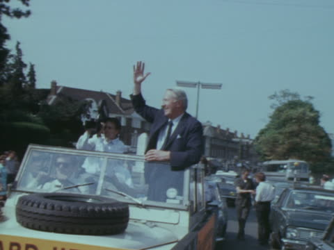 edward heath waves from a vehicle during election campaigning in croydon - edward heath stock-videos und b-roll-filmmaterial