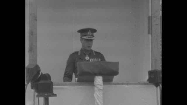 edward in military uniform gives speech standing at podium / cu french president lebrun listening to speech / shot of dignitaries and officers in... - british military stock videos and b-roll footage