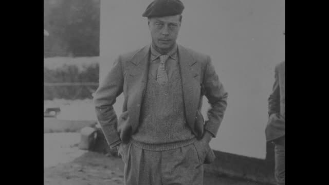 edward in tweed suit with sweater vest and beret / skiing outfit / note: exact year not known / note: film has nitrate deterioration - basco video stock e b–roll