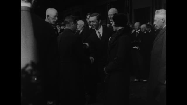 edward prince of wales and prince george duke of kent walk up building stairs and shake hands with a man / gustaf v of sweden shakes hands with the... - prince stock videos and b-roll footage