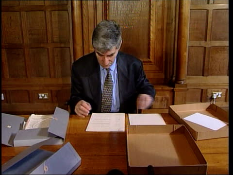 edward viii abdication papers held back itn oxford man sitting at desk looking through papers relating to abdication of king edward viii cms letter... - abdication stock videos and b-roll footage