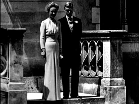 edward viii and wallis simpson on their wedding day at chateau de cande / they pose for photographs with herman rogers and the best man major... - エドワード8世点の映像素材/bロール