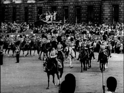 stockvideo's en b-roll-footage met edward viii marching in funeral procession for king george v / edward in uniform leading guards on horseback, he wears the bearskin headpiece /... - 1936