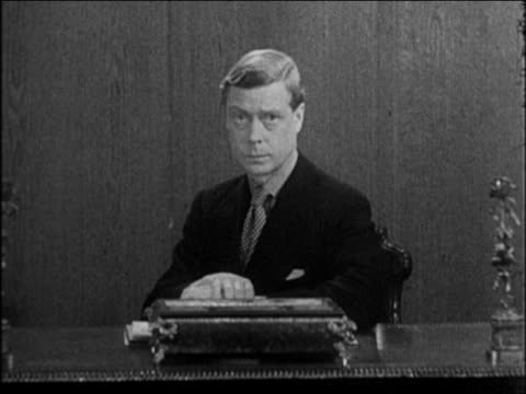 stockvideo's en b-roll-footage met edward viii sitting at desk giving radio address announcing abdication of throne / docu. - 1936