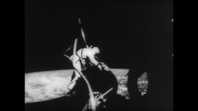 edwin 'buzz' aldrin's spacewalk during gemini 12 orbit / aldrin working on capsule with planet earth in background / aldrin picks up a white... - orbiting stock videos & royalty-free footage