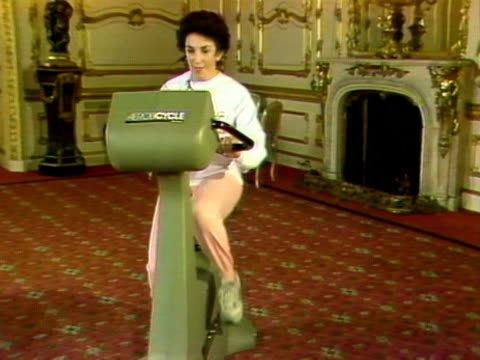 Edwina Currie rides an exercise bike during a publicity event for healthy living