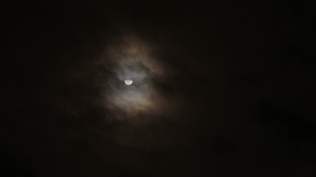 eerie moon and wispy clouds - rauchartig stock-videos und b-roll-filmmaterial