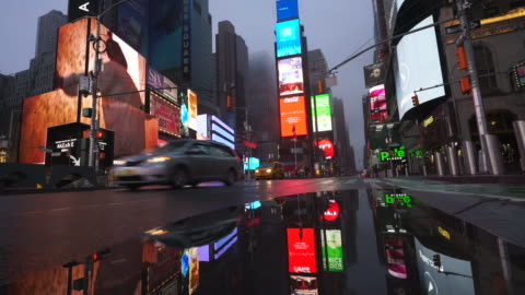 covid-19 effect to new york nightlife at times square. people and traffic disappeared from times square for impact of covid-19 in the rainy night to early morning on mar. 29 2020. - international landmark stock videos & royalty-free footage