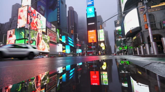covid-19 effect to new york nightlife at times square. people and traffic disappeared from times square for impact of covid-19 in the rainy night to early morning on mar. 29 2020. - mar stock videos & royalty-free footage