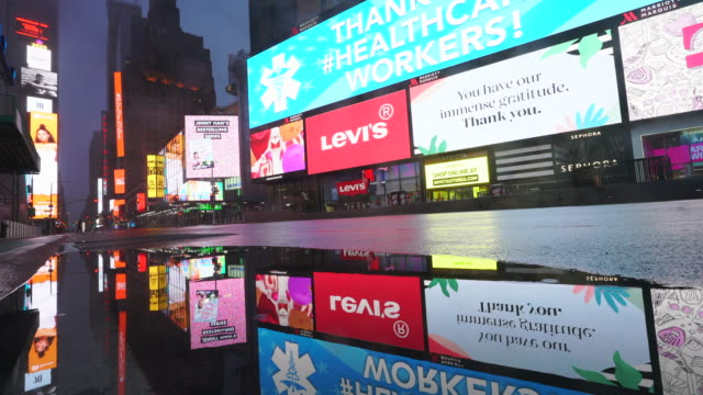 covid-19 effect to new york nightlife. people and traffic disappeared from times square for impact of covid-19 in the rainy night to early morning on mar. 29 2020. - billboard stock videos & royalty-free footage