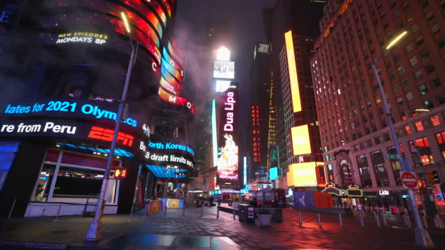 covid-19 effect to new york nightlife. people and traffic disappeared from times square for impact of covid-19 in the rainy night to early morning on mar. 29 2020. - message stock videos & royalty-free footage