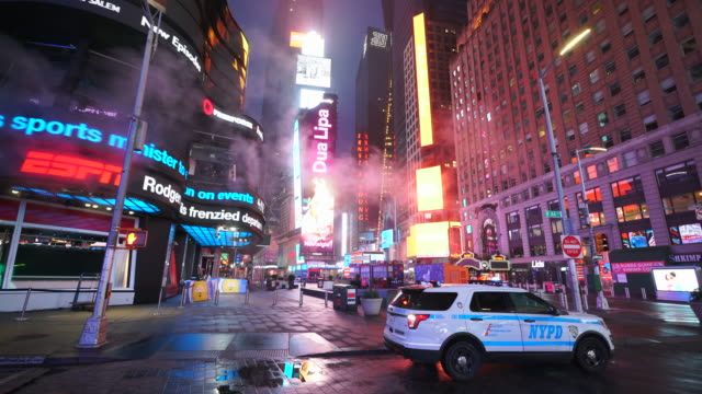covid-19 effect to new york nightlife. people and traffic disappeared from times square for impact of covid-19 in the rainy night to early morning on mar. 29 2020. - avenue stock videos & royalty-free footage