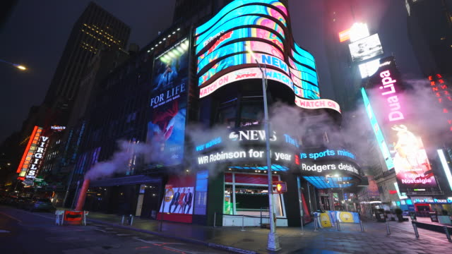 covid-19 effect to new york nightlife. people and traffic disappeared from times square for impact of covid-19 in the rainy night to early morning on mar. 29 2020. - new york city stock videos & royalty-free footage