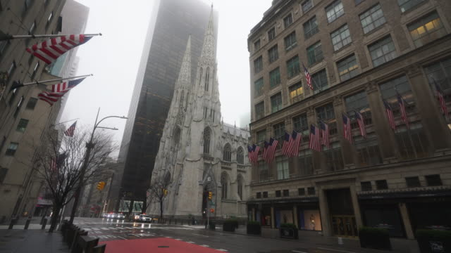 covid-19 effect to new york. people and traffic disappeared from midtown manhattan fifth avenue for impact of covid-19 in the rainy morning new york city ny usa on mar. 29 2020. - mar stock videos & royalty-free footage
