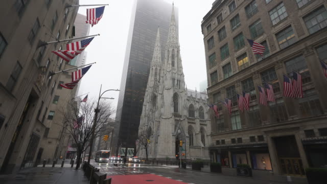 covid-19 effect to new york. people and traffic disappeared from midtown manhattan fifth avenue for impact of covid-19 in the rainy morning new york city ny usa on mar. 29 2020. - religion stock videos & royalty-free footage
