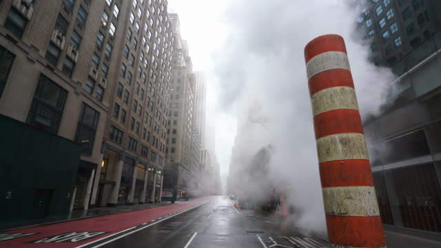 covid-19 effect to new york. people and traffic disappeared from midtown manhattan madison avenue for impact of covid-19 in the rainy morning new york city ny usa on mar. 29 2020. - mar点の映像素材/bロール