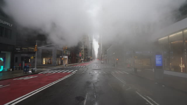 covid-19 effect to new york. people and traffic disappeared from midtown manhattan madison avenue for impact of covid-19 in the rainy morning new york city ny usa on mar. 29 2020. - mar stock videos & royalty-free footage