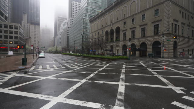 covid-19 effect to new york. people and traffic disappeared from midtown manhattan park avenue for impact of covid-19 in the rainy morning new york city ny usa on mar. 29 2020. - pedestrian crossing stock videos & royalty-free footage