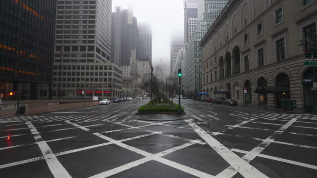 covid-19 effect to new york. people and traffic disappeared from midtown manhattan park avenue for impact of covid-19 in the rainy morning new york city ny usa on mar. 29 2020. - avenue stock videos & royalty-free footage