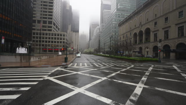 covid-19 effect to new york. people and traffic disappeared from midtown manhattan park avenue for impact of covid-19 in the rainy morning new york city ny usa on mar. 29 2020. - road signal stock videos & royalty-free footage
