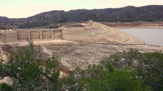 effects of california drought  on bradbury dam and lake cachuma - lake bed stock videos & royalty-free footage