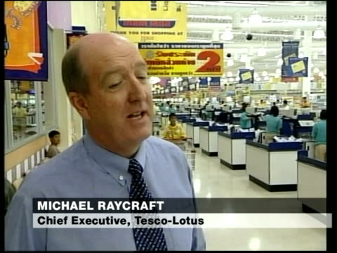 tesco in thailand michael raycraft interview sot my wife supplies tesco with small amount of products/ she's just sold her business/ i have declared... - tesco点の映像素材/bロール