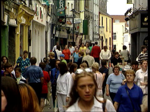 effects of weakness of the euro; lib irish republic: dublin: ext people along busy shopping street shop signs people crossing bridge - dublin republic of ireland stock videos & royalty-free footage