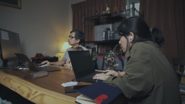 4k, covid-19 effects, work from home, busy asian family using laptop and smartphones. - boredom stock videos & royalty-free footage