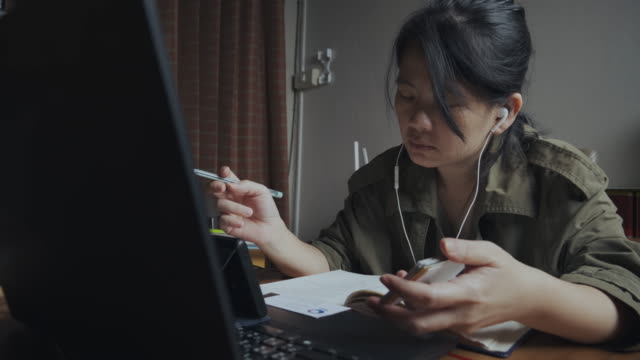 4k, covid-19 effects, work from home, busy asian woman meeting video call conference on laptop and smartphones. - boredom stock videos & royalty-free footage