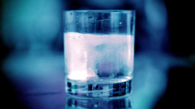 effervescent tablet in water with bubbles. - paracetamol stock videos and b-roll footage