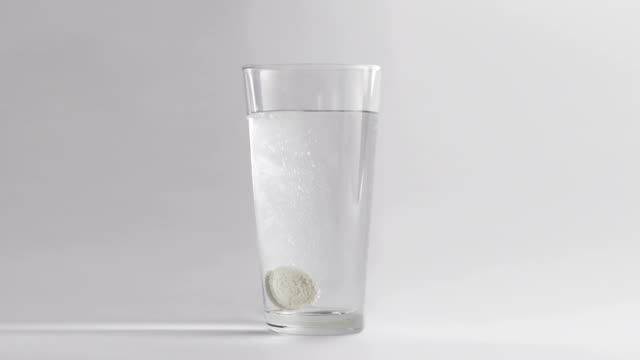 effervescent tablet on white background - aspirin stock videos & royalty-free footage