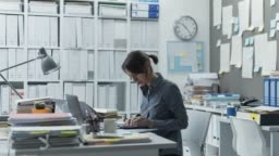 Efficient multitasking businesswoman working in the office, she is productive and skilled, video timelapse