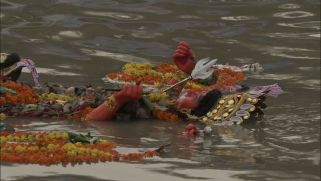 Effigy of Hindu gods float along in Hooghly river as part of Durga Puja festival, Kolkata Available in HD.