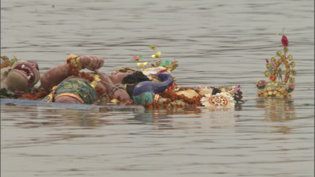 Effigy of Hindu gods floats along in Hooghly river as part of Durga Puja festival, Kolkata Available in HD.