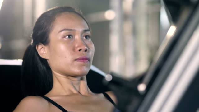 effort : asian woman exercising in the gym - self improvement stock videos & royalty-free footage