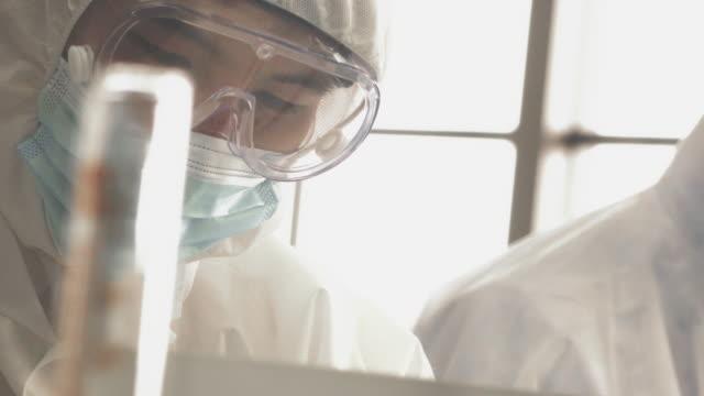 effort team - biotechnology stock videos & royalty-free footage