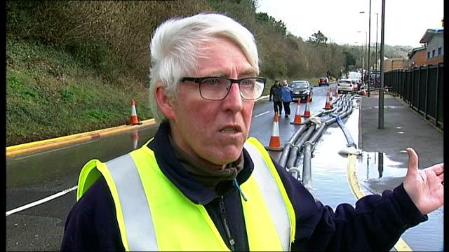 vídeos de stock e filmes b-roll de efforts to prevent flooding at kenley water treatment works; england: london: croydon: ext car driving through floodwater floodwater being pumped... - croydon inglaterra