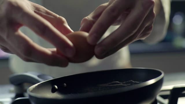 egg into frying pan, slow motion - egg yolk stock videos and b-roll footage